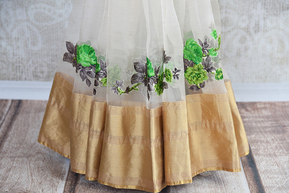 Very beautiful tissue saree with green floral applique work thought out the gold border. Be the center of any Party.-gold border with applique work