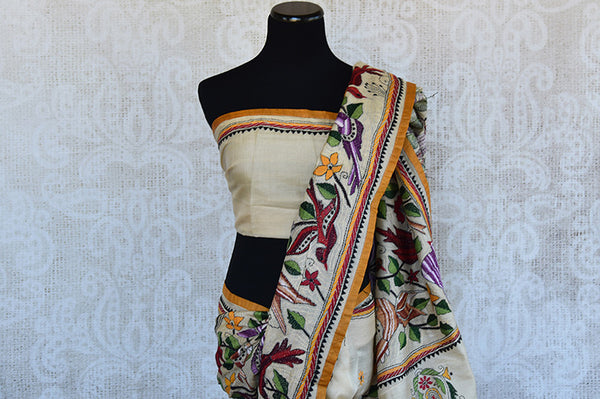 Buy this alluring beige kantha tussar silk Indian saree with printed floral design in pallu and border from Pure Elegance online, NJ. Great for festive occasions-Pallu and Border