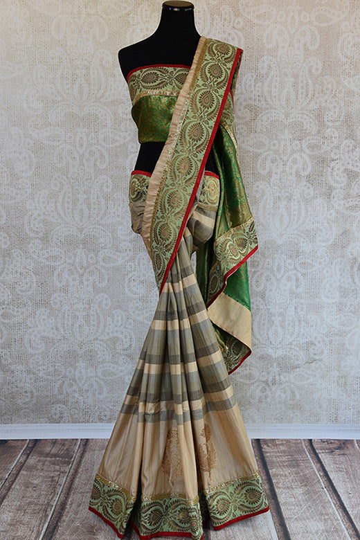 Designer tussar silk with beautiful banarasi border and body has large buta. This is perfect party saree good for all-Full view