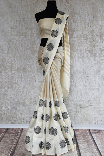 Classic white linen with circle embroidery. Get this elegant look ideal for Indian festivals and parties. -full view