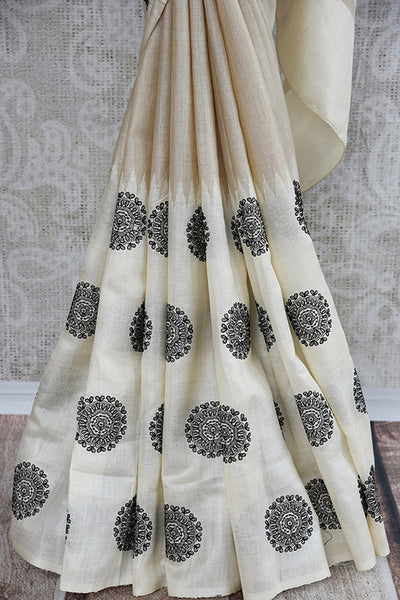 Classic white linen with circle embroidery. Get this elegant look ideal for Indian festivals and parties. -lower view