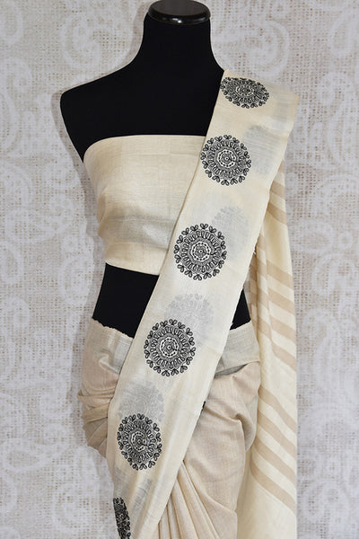 Classic white linen with circle embroidery. Get this elegant look ideal for Indian festivals and parties. -Top view
