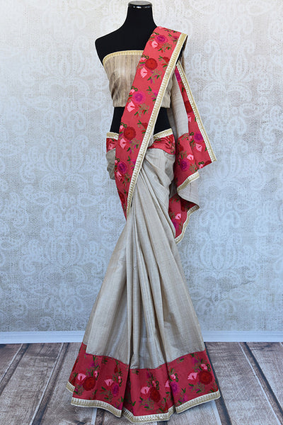 Classic beige tussar with beautiful floral embroidery saree. Perfect silk saree for Indian parties and get a classy look.-Full view