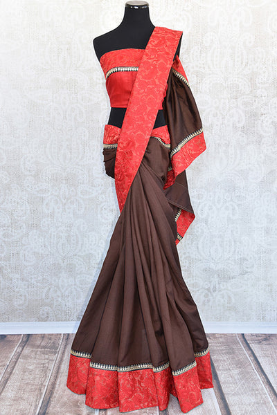 Brown tussar with thread embroidery on red silk border saree. Modern and chic saree on ethnic tussar perfect for Indian events.-full view