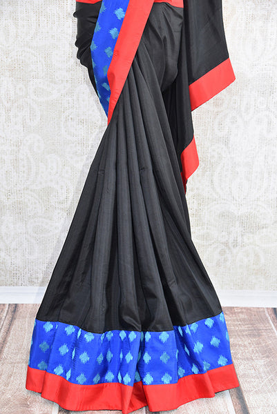 Pure Elegance's Black silk saree with blue and red concept work.. Classic bold and beautiful saree with perfect for Indian Parties.- pleats
