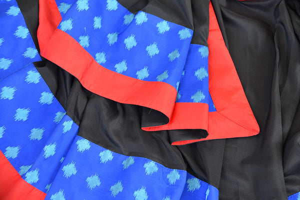 Pure Elegance's Black silk saree with blue and red concept work.. Classic bold and beautiful saree with perfect for Indian Parties.-close up