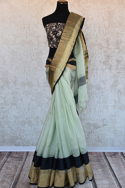 Buy this gorgeous light green chanderi silk indian sari with black gold pallu border and kalamkari blouse piece from pure elegance store. Great for party wear-Full View