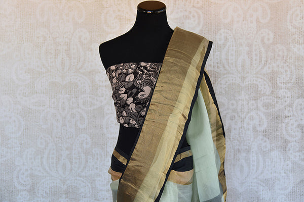 Buy this gorgeous light green chanderi silk indian sari with black gold pallu border and kalamkari blouse piece from pure elegance store. Great for party wear-Pallu