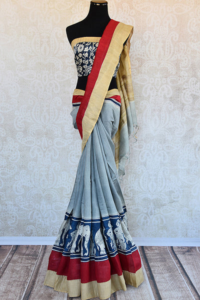 Buy this elegant off white linen Indian saree with kalamkari print and red gold border and attached kalamkari blouse from Pure Elegance online. Great for parties-Full View