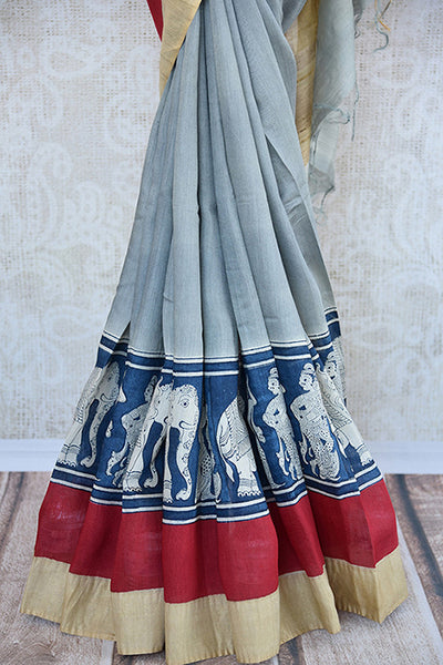 Buy this elegant off white linen Indian saree with kalamkari print and red gold border and attached kalamkari blouse from Pure Elegance online. Great for parties-Kalamkari Border