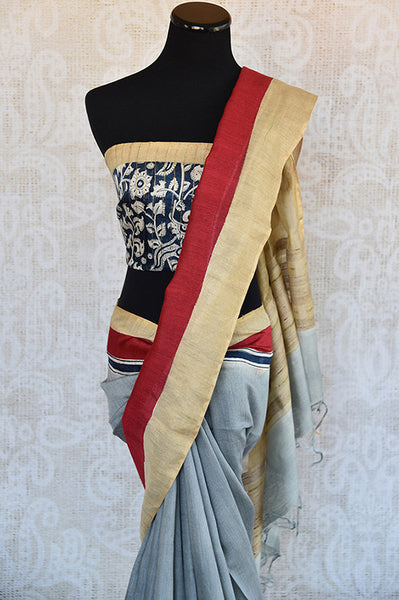 Buy this elegant off white linen Indian saree with kalamkari print and red gold border and attached kalamkari blouse from Pure Elegance online. Great for parties-Blouse and Pallu