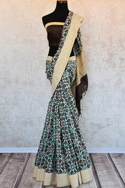 Buy this gorgeous bluish black printed linen Indian saree with gold border and black linen blouse piece from Pure Elegance online. Great for formal evenings-Full View