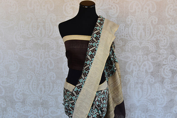 Buy this gorgeous bluish black printed linen Indian saree with gold border and black linen blouse piece from Pure Elegance online. Great for formal evenings-Pallu and Border