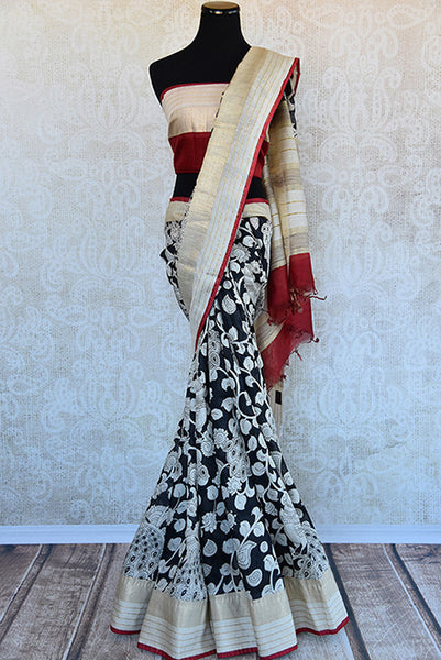 Buy this classic black printed linen Indian saree with white floral print gold beige border and red linen blouse piece from Pure Elegance store. Great for parties-Full View