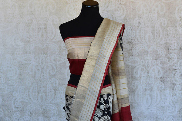 Buy this classic black printed linen Indian saree with white floral print gold beige border and red linen blouse piece from Pure Elegance store. Great for parties-Pallu and Border