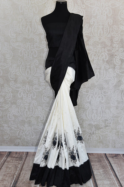 White ikkat silk saree with black thread embroidery and black border and pallu.Graceful as well as glamorous pick.-Full view