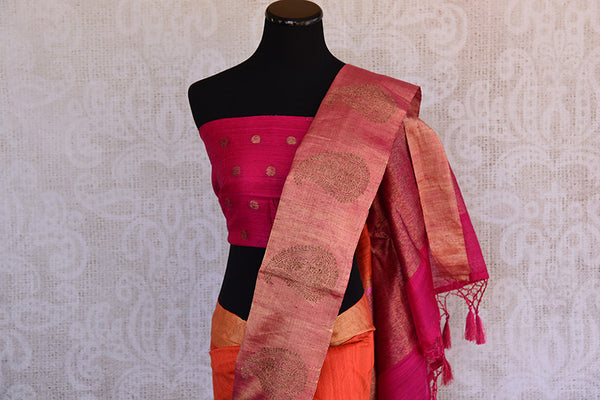 Orange matka banarasi saree with shiny pink banarasi buta border and pallu. Perfect for Puja and festivals.- gold buta