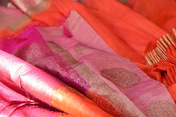 Orange matka banarasi saree with shiny pink banarasi buta border and pallu. Perfect for Puja and festivals.-close up
