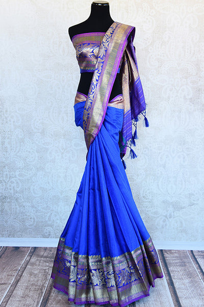 Blue Tussar saree with floral pattern border and pallu having hues of pink and yellow . Perfect traditional look.-full view