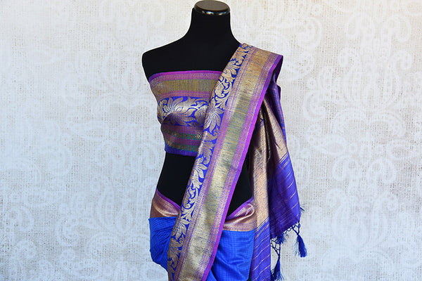 Blue Tussar saree with floral pattern border and pallu having hues of pink and yellow . Perfect traditional look.-pallu