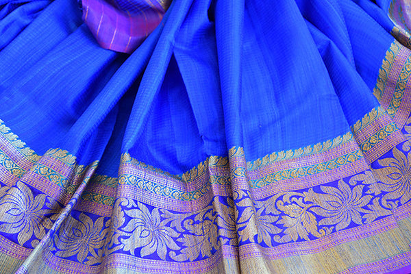 Blue Tussar saree with floral pattern border and pallu having hues of pink and yellow . Perfect traditional look.-close up