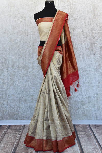 Beige and red tussar silk party saree with banarasi zari weave comes with beautiful red border and pallu.-full view