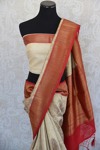 Beige and red tussar silk party saree with banarasi zari weave comes with beautiful red border and pallu.- pallu