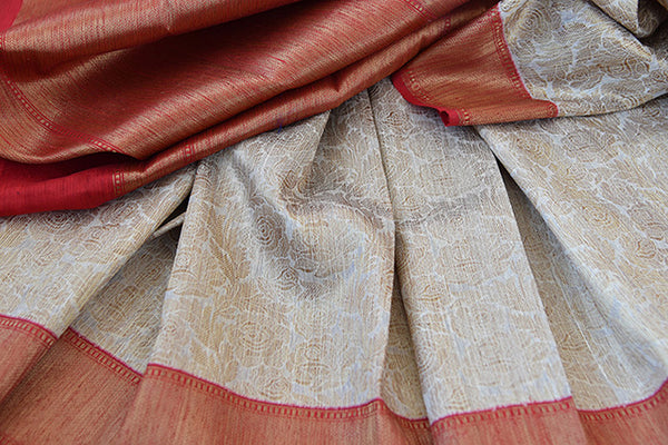 Beige and red tussar silk party saree with banarasi zari weave comes with beautiful red border and pallu.-close up