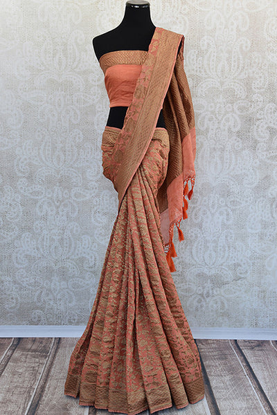 Orange Tissue silk sari with banarasi weave all over available at our store Pure Elegance. Classy modern saree with traditional weaving ideal for Indian wedding.-Full view