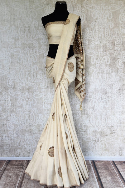 Pure Elegance presents exquisite Muga Banarasi Saris online for Indian women in USA. Buy graceful off white woven Muga Banarasi saree online or visit our store in USA.-full view