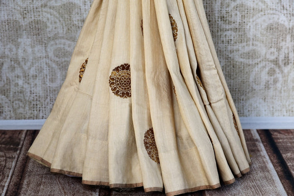 Pure Elegance presents exquisite Muga Banarasi Saris online for Indian women in USA. Buy graceful off white woven Muga Banarasi saree online or visit our store in USA.-pleats