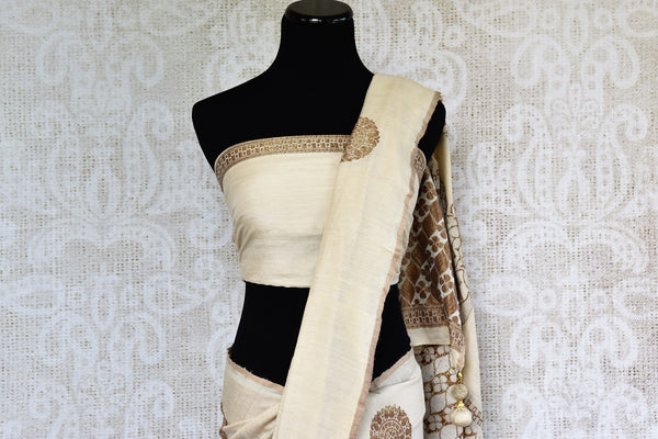 Pure Elegance presents exquisite Muga Banarasi Saris online for Indian women in USA. Buy graceful off white woven Muga Banarasi saree online or visit our store in USA.-pallu