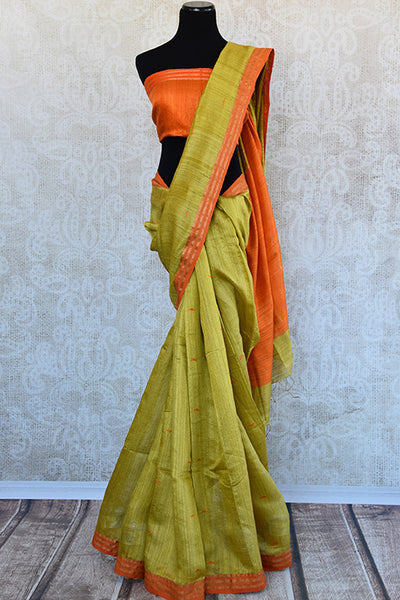 Simple and Elegant green matka silk saree with orange pallu and blouse piece. Perfect saree for Indian pujas and festivals.-full view
