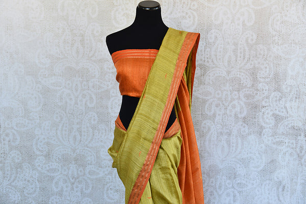 Simple and Elegant green matka silk saree with orange pallu and blouse piece. Perfect saree for Indian pujas and festivals.-top view