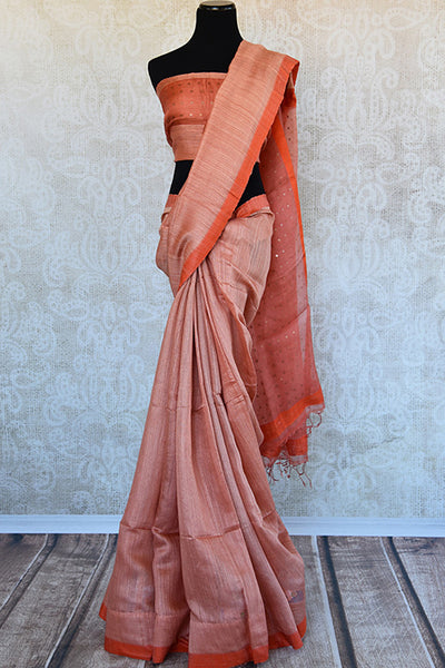 Peach orange matka silk saree with the hue of pink color. Classic and ethnic saree perfect for Indian events.-Full View