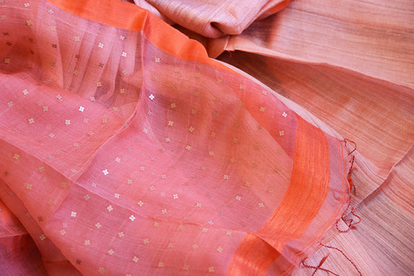 Peach orange matka silk saree with the hue of pink color. Classic and ethnic saree perfect for Indian events.-close up