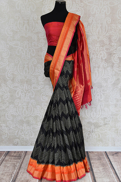 Classic black and red silk ikkat saree available at Indian women clothing store Pure Elegance in USA. Perfect ethnic saree for family gatherings and festivals.-full view