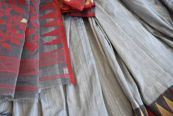 Pure Elegance concept designer grey raw silk dhakai saree with maroon blouse piece.Traditionally perfect silk saree for Indian evening parties.-close up