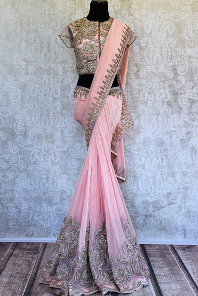 This pink embroidered concept sari comes with an elegant stitch designer blouse piece with gold embroidery. Buy from Pure Elegance online USA Store. - full