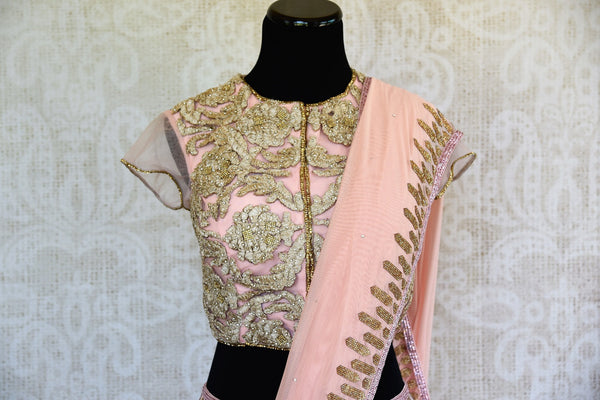 This pink embroidered concept sari comes with an elegant stitch designer blouse piece with gold embroidery. Buy from Pure Elegance online USA Store. - top