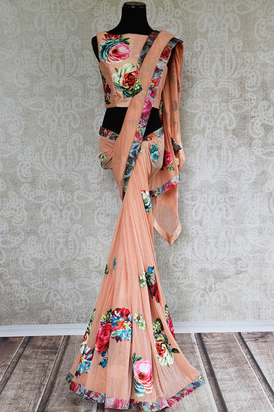 Classy pinkish peach stretched net saree with pre stitched designer blouse. Perfect party style saree for Indian events.-full view