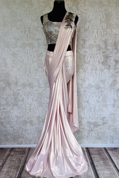 Buy this glamorous pink embroidered Georgette concept saree. Comes with a stitch designer blouse piece with gold floral embroidery. Available from Pure Elegance online USA Store. - full