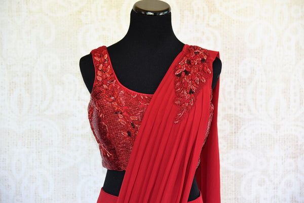 This red embroidered georgette concept sari comes with a beautiful stitch designer blouse piece. Buy from Pure Elegance online USA store. - top