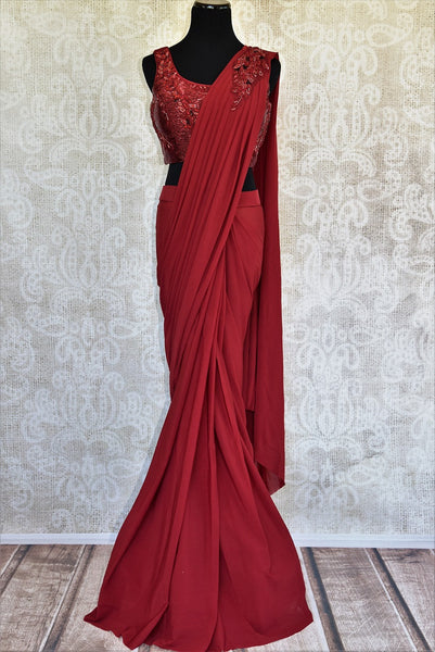This red embroidered georgette concept sari comes with a beautiful stitch designer blouse piece. Buy from Pure Elegance online USA store. - full