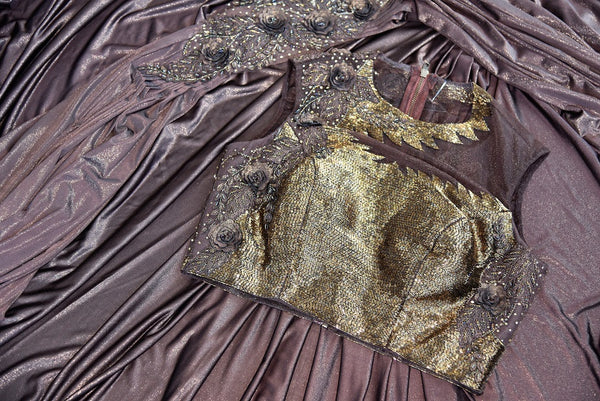 Buy this beautiful brown georgette concept saree with floral embroidery. Comes with a copper-colored stitch designer blouse piece. Available from Pure Elegance online USA store. - close up