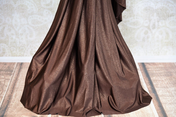 Buy this beautiful brown georgette concept saree with floral embroidery. Comes with a copper-colored stitch designer blouse piece. Available from Pure Elegance online USA store. - bottom