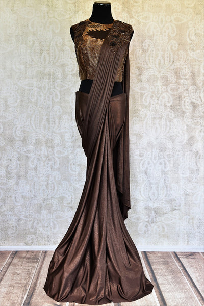 Buy this beautiful brown georgette concept saree with floral embroidery. Comes with a copper-colored stitch designer blouse piece. Available from Pure Elegance online USA store. - full
