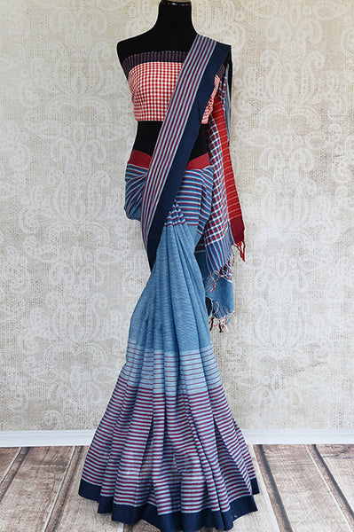 This is a woven blue - dark blue saree, stripped design pink checked blouse, thick blue border and checked pallu. It is perfect for party and festive occasion. front view