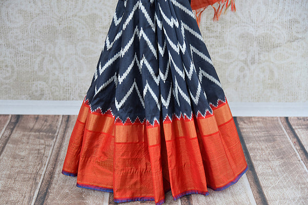 Classic grey and white chevron pattern ikkat silk saree with orange pallu and border. Perfect ethnic saree to enhance your Indian wardrobe.-border