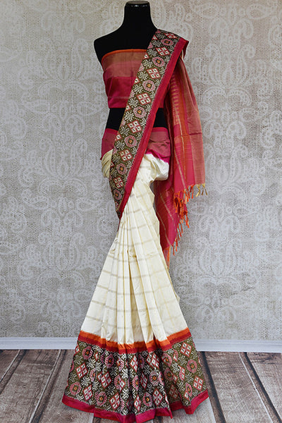 Elegant white ikkat silk saree with red ikkat border and pallu. perfect for Indian festive events.-Full view
